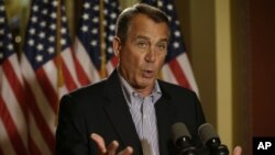 House Speaker John Boehner of Ohio gestures as he speaks during a news conference on Capitol Hill in Washington to discuss the pending fiscal cliff, December 7, 2012.
