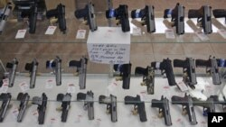 Handguns are on display at B & J Guns in Colonie, New York, June 26, 2008. The Supreme Court ruled that Americans have a constitutional right to keep guns in their homes for self-defense.