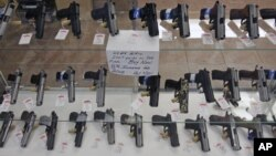 Handguns are on display at B & J Guns in Colonie, New York, June 26, 2008. The Supreme Court ruled that Americans have a constitutional right to keep guns in their homes for self-defense, the justices' first major pronouncement on gun control in U.S. his