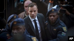 Oscar Pistorius, center, arrives at the High Court in Pretoria, South Africa, July 6, 2016.
