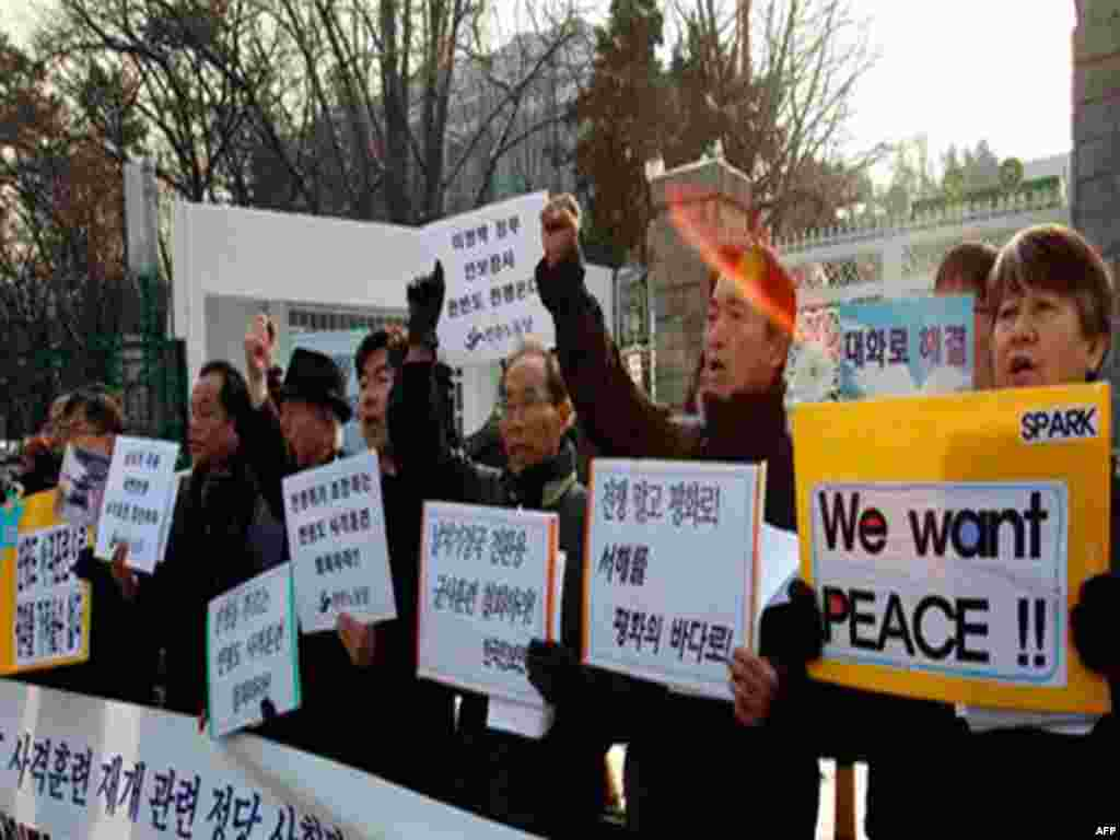 South Korean protesters shout slogans during a rally denouncing South Korea's live-fire drills on Yeonpyeong Island, in front of Defense Ministry in Seoul, South Korea, Friday, Dec. 17, 2010. South Korea's Joint Chiefs of Staffs said in a statement that m