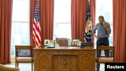 Obama Ukrayna krizinin başlangıcından bu yana sık sık Putin'le telefonlaşıyor