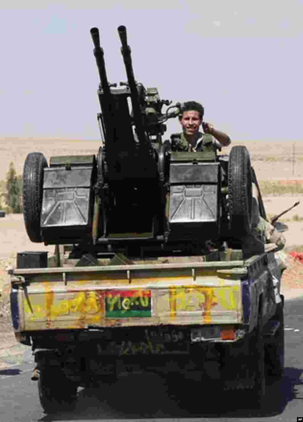 An NTC fighter outside Bani Walid heads to front, Libya, September, 10, 2011. - E. Arrott