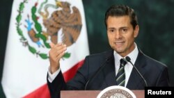 FILE - Mexico's President Enrique Pena Nieto delivers a speech in Mexico City, Mexico, Nov. 4, 2016.