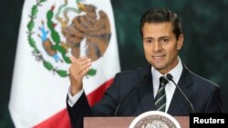 FILE - Mexico's President Enrique Pena Nieto delivers a speech in Mexico City, Mexico, Nov. 4, 2016.