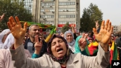 Protesters chant slogans as they protest Saturday's bombing attacks, during a rally in Ankara, Oct. 11, 2015.