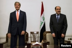 Iraqi Prime Minister Nouri al-Maliki, right, and U.S. Secretary of State John Kerry meet at the Prime Minister's Office in Baghdad, Iraq, June 23, 2014.