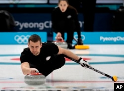 FILE - Russian curler Alexander Krushelnitsky practices ahead of the 2018 Winter Olympics in Gangneung, South Korea, Feb. 7, 2018.