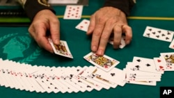 FILE - Cards are reset during a break in poker play at Caesar's Palace in Las Vegas, Feb. 27, 2013.