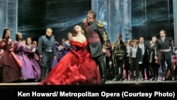 Enraged by Iago's lies about Desdemona's faithfulness, Otello (Aleksandrs Antonenko) loses control and insults her in front of the Venetian court. (Credit: Ken Howard/ Metropolitan Opera)