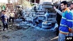 Hiện trường sau vụ đánh bom xe tại Baghdad, ngày 27/1/2011