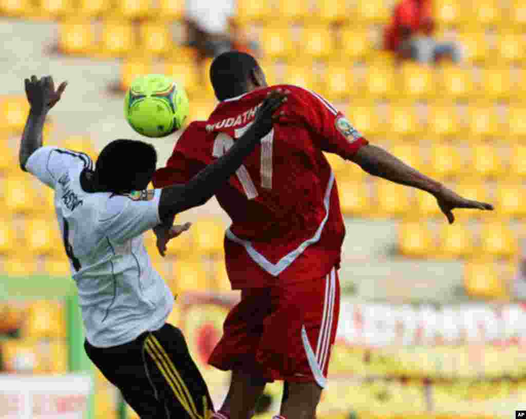 Massunguna of Angola fights for the ball with Ibrahim of Sudan during their African Nations Cup soccer match in Malabo