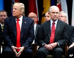 FILE - President Donald Trump and Attorney General Jeff Sessions attend the FBI National Academy graduation ceremony in Quantico, Va., Dec. 15, 2017.
