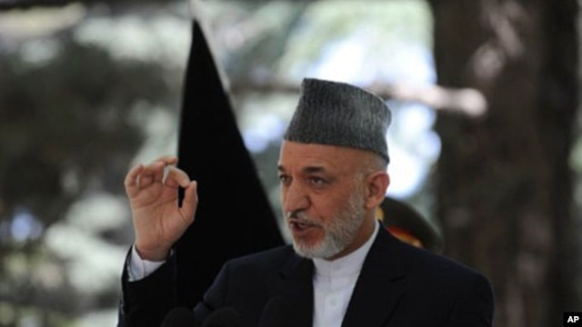 Afghan President Hamid Karzai speaks during a press conference at the Presidential palace in Kabul, May 31, 2011