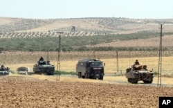 FILE - Turkish troops return from the Syrian border, in Karkamis, Turkey, Aug. 27, 2016. Turkey on Wednesday sent tanks across the border to help Syrian rebels retake the key Islamic State-held town of Jarablus.