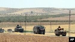 지난 8월 터키군이 국경 너머 시리아 카르카미스에서 작전을 수행한 후 복귀하고 있다. (자료사진)