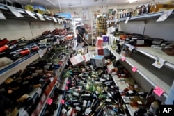 Bottles of wine are strewn in the middle of an aisle in the Eastridge Market in Ridgecrest, California, July 6,2019, after Friday night's 7.1-magnitude earthquake, which jolted an area from Sacramento to Mexico.