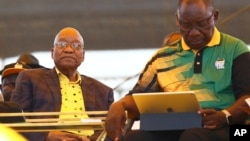 Newly-elected ruling African National Congress (ANC) party president, Cyril Ramaphosa, right, and former ANC president and South African President Jacob Zuma, left, attend the party's 106th birthday celebrations in East London, South Africa, Jan. 13, 2018.