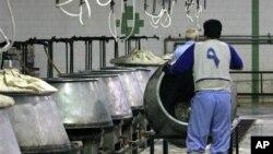 FILE - Iranian prisoners work in a kitchen in the Evin prison, Tehran.