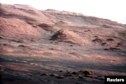 FILE - The base of Mars' Mount Sharp is pictured in this August 27, 2012 NASA handout photo taken by the Curiosity rover.
