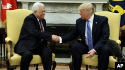 President Donald Trump shakes hands with with Palestinian leader Mahmoud Abbas during their meeting in the Oval Office of the White House, May 3, 2017, in Washington.