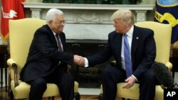 FILE - President Donald Trump shakes hands with with Palestinian leader Mahmoud Abbas during their meeting in the Oval Office of the White House, May 3, 2017, in Washington.