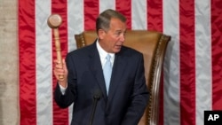 U.S. Representative John Boehner of Ohio holds the gavel after being re-elected to a third term as House speaker during the opening session of the 114th Congress in Washington, Jan. 6, 2015.