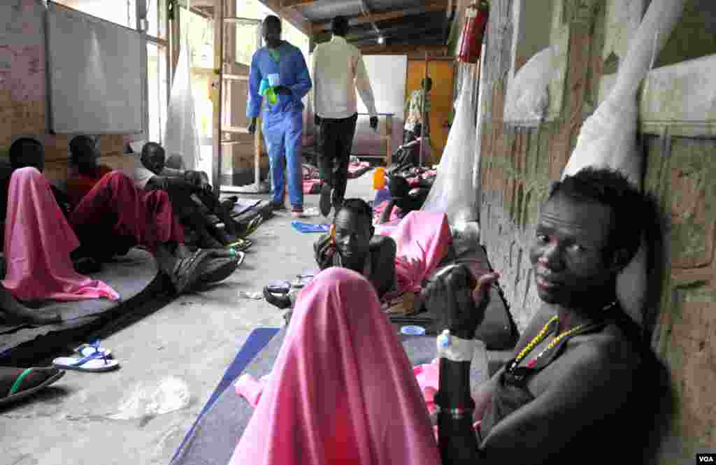 Wounded fighters from the Lou Nuer ethnic group, most of whom suffered gunshot wounds from fighting with Murle in Jonglei state, recover at a hospital in the state capital Bor.