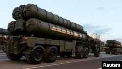 FILE - Russian S-400 air defense mobile missile launching systems are seen in Minsk, July 3, 2014.