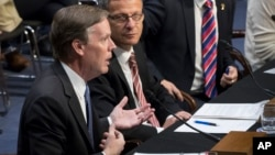 From left, former ambassador Nicholas Burns; Janis Sarts, director of the NATO Strategic Communication Center of Excellence; and Vesko Garcevic of Boston University (not seen), testify on Capitol Hill in Washington, June 28, 2017.