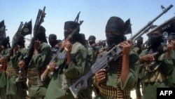 FILE - Fighters loyal to Somalia's al-Shabab group perform military drills at a village in Lower Shabelle region, some 25 kilometers outside Mogadishu, Feb. 17, 2011.