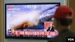 電視畫面顯示南韓也向北韓領海開炮