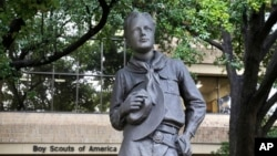 In this Wednesday, Feb. 12, 2020, photo, a statue stands outside the Boys Scouts of America headquarters in Irving, Texas. The Boy Scouts of America has filed for bankruptcy protection as it faces many of new sex-abuse lawsuits. (AP Photo/LM Otero)
