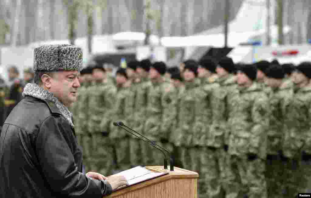 Ukraine's President Petro Poroshenko delivers a speech during his visit to the training center of the Ukrainian National Guard outside Kyiv, in this handout picture. Poroshenko said the country is still a long way from peace and that there are no guarantees a ceasefire deal agreed upon in Belarus Thursday would take effect.