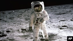 "July 1969: Astronaut Buzz Aldrin walks on the surface of the Moon near the leg of the Lunar Module (LM) ""Eagle"" during the Apollo 11 extravehicular activity (EVA). Astronaut Neil Armstrong, commander, took this photograph with a 70mm lunar surface camera."