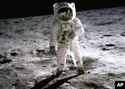 FILE - Astronaut Buzz Aldrin walks on the surface of the moon in this photo taken by Neil Armstrong.