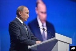 Russian President Vladimir Putin addresses a regional meeting of pro-Kremlin United Peoples' Front in Stavropol, on Monday, Jan. 25, 2016.