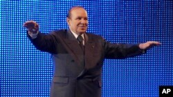 FILE - In this Feb.12 2009 photo, Algerian President Abdelaziz Bouteflika waves during a rally in Algiers.