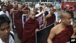 Buddhist monks march to protest against crackdown on protesters at the Letpadaung copper mine in Monywa, northwestern Myanmar, in Yangon, Myanmar, Friday, Nov. 30, 2012. Opposition leader Aung San Suu Kyi publicly criticized the forcible crackdown on prot