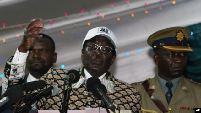 Zimbabwe's President and leader of ZANU-PF Robert Mugabe (C) delivers a speech at the party's 12th National People's Conference in Bulawayo, December 10, 2011.