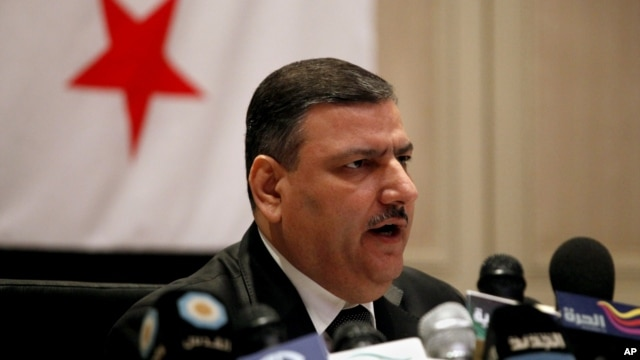 Riad Hijab, Syria's defected former prime minister, speaks at a press conference at the Hyatt Hotel in Amman, Jordan, August 14, 2012.