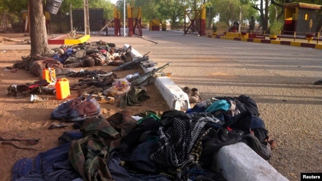 FILE - Weapons, personal items and bodies of Boko Haram fighters are seen at a roadside.