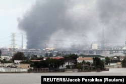 Nigeria, Lagos, Smoke rises from Lagos mainland