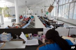 FILE - People get treatment at Haiti's first permanent cholera center, run by Gheskio Centers, in downtown Port-au-Prince, Haiti, Feb. 24, 2016.
