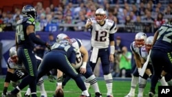 New England Patriots quarterback Tom Brady (12) calls a play against the Seattle Seahawks during the first half of Super Bowl XLIX in Glendale, Arizona, Feb. 1, 2015.