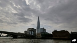 FILE - The Shard skyscraper is seen from the Thames river in London, June 19, 2014. A new report says a drone just missed hitting an A320 passenger plane flying above the Shard in July.