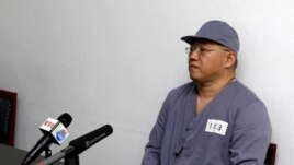 FILE - American missionary Kenneth Bae speaks to reporters at Pyongyang Friendship Hospital, N. Korea, Jan. 20, 2014.