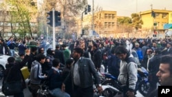 FILE - In this photo taken by an individual not employed by the Associated Press and obtained by the AP outside Iran, demonstrators gather to protest against Iran's weak economy, in Tehran, Iran, Dec. 30, 2017.