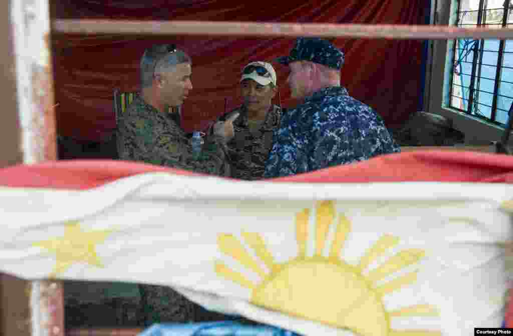 From left to right: U.S. Marine Corps Brig. Gen. Paul Kennedy, commanding general, 3d Marine Expeditionary Brigade; Philippine navy Capt. Roy Vincent Trinidad, officer in charge, Tacloban airfield; and U.S. Navy Rear Adm. Mark Montgomery, commander, Battl