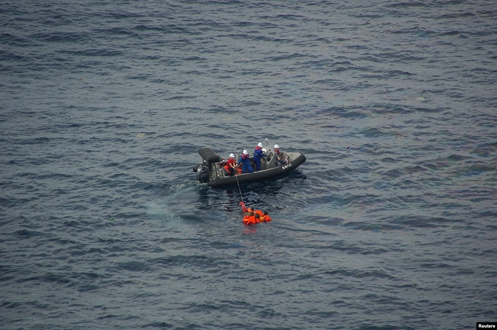 Crew members of Japan's Fisheries Agency rescue North Korean fishermen after their boat sank in a crash with Japanese patrol boat in the Yamato Shallows, about 400 kilometers off the western coast of Japan. (Image provided by Japan Coast Guard. 9th Regional Coast Guard Headquarters)